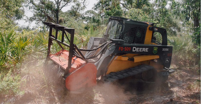 To assist in fuel reduction, the Florida Forest Service utilized light machinery to clear overgrown vegetation behind homes in close proximity to the preserve.