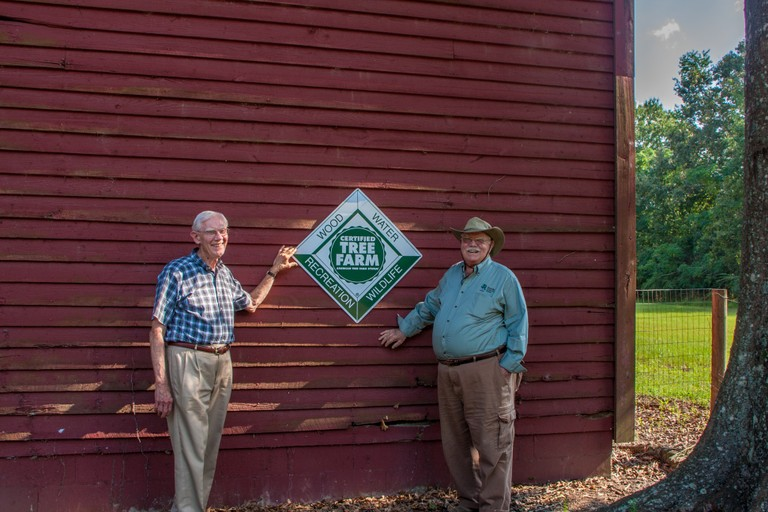 landowners with ATFS Certification sign