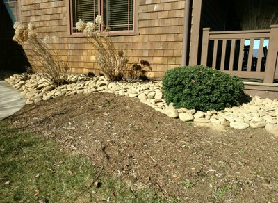 Homeowners replaced the mulch around this dwelling with non-flammable river rock.
